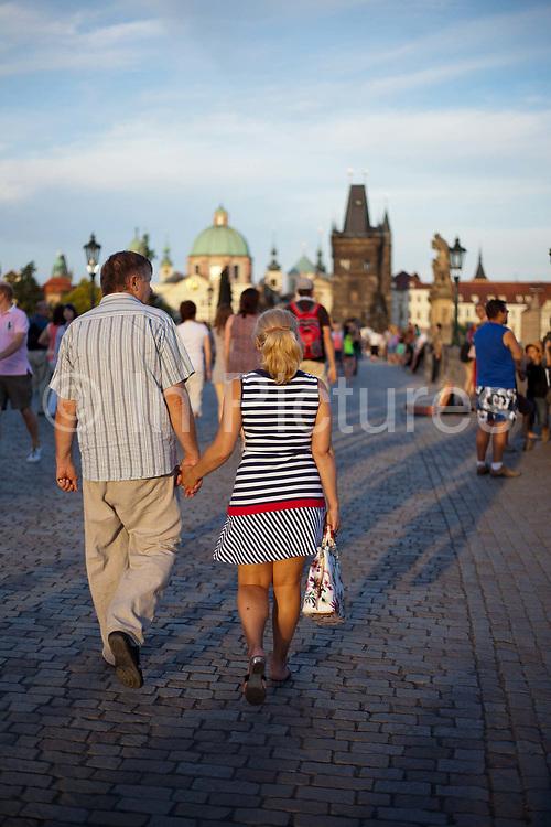 Romance on Charles Bridge; Prague, Czech Republic.