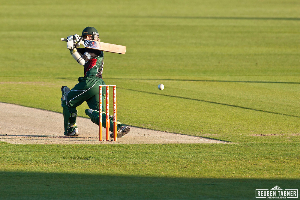 James Taylor of Leicestershire Foxes sweeps the ball behind as he bats against Ben Harmison of Durham Dynamos.