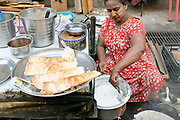 Freshly prepared pancakes for sale at an early morning street market in Yangon, Myanmar on 18th May 2016.  A large variety of local products are available for sale in fresh markets all over Yangon, all being sold on small individual stalls