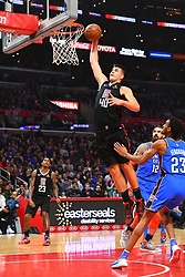 March 8, 2019 - Los Angeles, CA, U.S. - LOS ANGELES, CA - MARCH 08: Los Angeles Clippers Center Ivica Zubac (40) goes up for a dunk during a NBA game between the Oklahoma City Thunder and the Los Angeles Clippers on March 8, 2019 at STAPLES Center in Los Angeles, CA. (Photo by Brian Rothmuller/Icon Sportswire) (Credit Image: © Brian Rothmuller/Icon SMI via ZUMA Press)