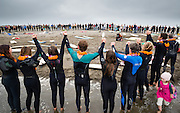 A large crowd of friends and family celebrate the life of Brad Parker (36), during a paddle out memorial service at the Russian River Mouth near Jenner, California. An avid surfer and rock climber, Brad was killed in a fall while traversing Matthes Crest in Yosemite National Park on August 16, 2014, just hours after proposing to his girlfriend, Jainee Dial, on the summit of Cathedral Peak.