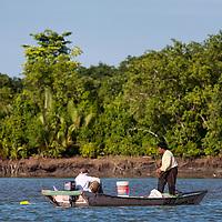 Two fishermen on Sarawak River, Santubong Peninsula.