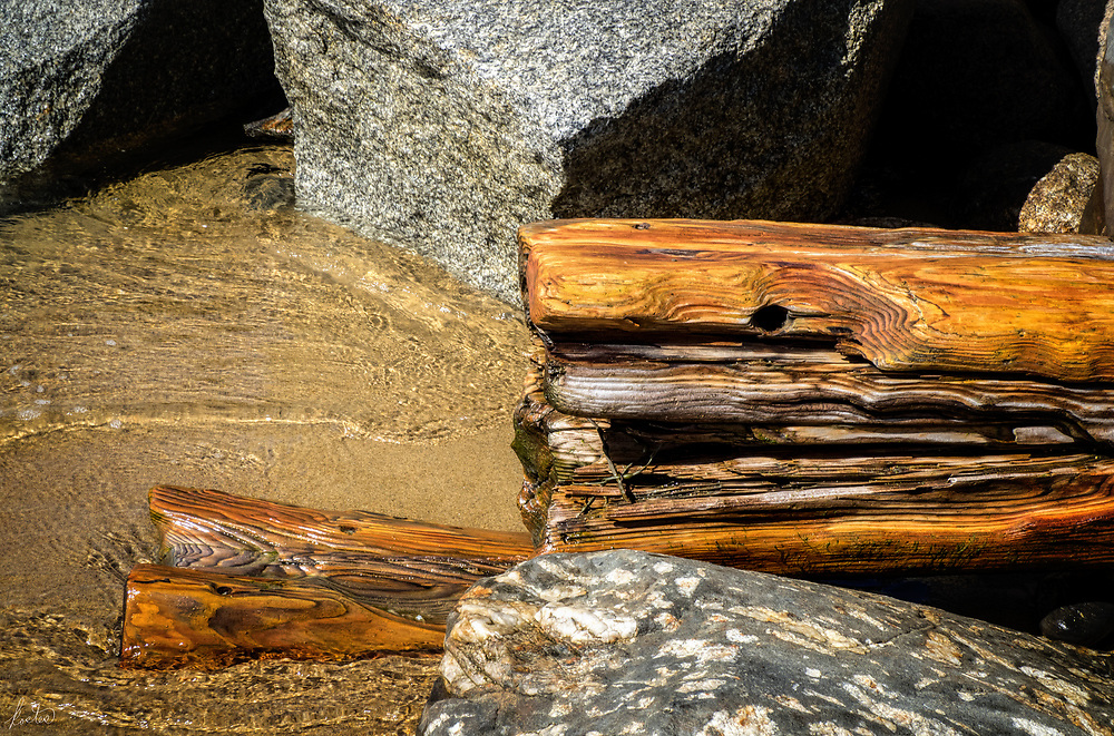 Rocks,wood,sand & water at Old Orchard Beach, Maine