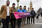 Thousands of people including police officers and Muslim faith leaders gathered on Westminster Bridge to hold a vigil and a minutes silence one week after the terror attack, on March 29th 2017 in London, United Kingdom. Young Muslims from the Ahmadiyya community, several holding banners that read, Love for all, hatred for none.
