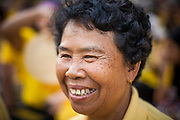 05 DECEMBER 2012 - BANGKOK, THAILAND:  A woman on the Royal Plaza smiles while she watches Bhumibol Adulyadej, the King of Thailand, on CCTV during his public audience from the Mukkhadej balcony of the Ananta Samakhom Throne Hall. December 5 is a national holiday. It's also celebrated as Father's Day. Celebrations are being held across the country to mark the birthday of Bhumibol Adulyadej, the King of Thailand.   PHOTO BY JACK KURTZ