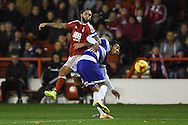 Nottingham Forest midfielder Henri Lansbury (10) battles for possession with Queens park Rangers defender James Perch (24) during the EFL Sky Bet Championship match between Nottingham Forest and Queens Park Rangers at the City Ground, Nottingham, England on 5 November 2016. Photo by Jon Hobley.