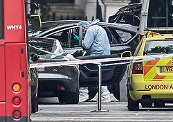 © Licensed to London News Pictures. 07/10/2017. London, UK. A police forensics officer takes a photograph into the passenger seat of a vehicle thought to have been driven into pedestrians in an incident is seen outside the Natural History Museum. Early reports say a man has been arrested after pedestrians injured. Photo credit: Peter Macdiarmid/LNP