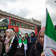 An Anti-Assad Syrian demonstration held in Whitehall, Central London. The demonstration was called by the Syrian Community in the UK under the head lines; Syrians are being killed in a genocide and the world is watching. Several hundreds gathered opposite Downing Street 10 calling for Syrians to unite and the world to intervene.