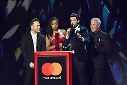 EDITORIAL USE ONLY.<br /><br />Jennifer Hudson, Sir Tom Jones and Olly Murs, with Jack Whitehall, on stage at the Brit Awards at the O2 Arena, London.