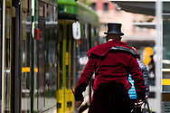 A man wearing a top hat is seen walking to wards a tram during COVID-19 in Melbourne, Australia. Premier Daniel Andrews announced today that some minor changes will be made to the current Stage 4 Restrictions in Melbourne. As yet, there is no sign of any meaningful change despite numbers of new cases being under 5 for the 14 day rolling average. Zero cases and no deaths were recorded in the past 24 hours in Victoria. (Photo by Dave Hewison/Speed Media)