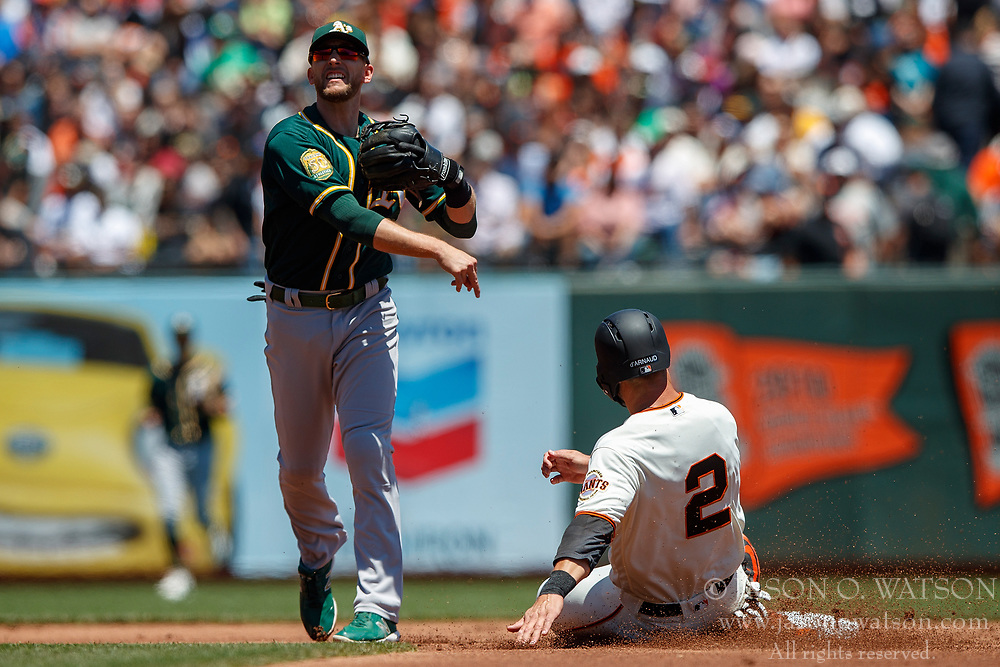 SAN FRANCISCO, CA - JULY 15: Jed Lowrie #8 of the Oakland Athletics completes a double play over Chase d'Arnaud #2 of the San Francisco Giants during the first inning at AT&T Park on July 15, 2018 in San Francisco, California.  (Photo by Jason O. Watson/Getty Images) *** Local Caption *** Jed Lowrie; Chase d'Arnaud