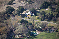 """EXCLUSIVE: Michael Jackson's former Neverland ranch is still yet to find a buyer almost three years after it went on the market to much fanfare with a $100million price tag. Photos taken January 2018 show the estate looking deserted, and while minimal upkeep has kept the famous floral clock intact, much of the surrounding grounds look sun-scorched and barren. The sprawling 3,000-acre property located near Santa Barbara, California, underwent extensive restoration efforts in 2013 in a bid to bring it back to it to its former glory. Jackson's children were involved in that effort, adding new features including a zen garden to replace the bustling fairground that once was, plus a 'boy in the moon' feature in one area of the grounds in homage to their late father's favorite fairytale character Peter Pan, who inspired the ranch's name. The estate was rebranded as Sycamore Valley Ranch when it was put up for sale in May 2015 with a $100million asking price. After no buyers were found, the price was reduced to $67 million in March 2017, but still nobody has come forward to buy it. In addition to a 12,500 sq ft main residence and a 3,700 sq ft pool house, the listing boasted a separate building with a 50-seat movie theater and a dance studio. Other features that remained included Jackson's """"Disney-style"""" train station (minus the train), a fire house and a barn. Jackson, who died in 2009 from an overdose, bought the property for $30 million in 1988 and lived in it until the estate was raided by police as part of his 2005 child molestation trial, in which he was eventually acquitted on all charges. After the star quit the ranch, the estate went on a downward spiral and fell into disrepair. In 2008, a year before Jackson's death, the attractions from the centerpiece amusement park located on the grounds were removed and trucked down the highway. Jackson acquired around 18 fairground rides during his years at Neverland and since 2009 some now feature at the Cali"""