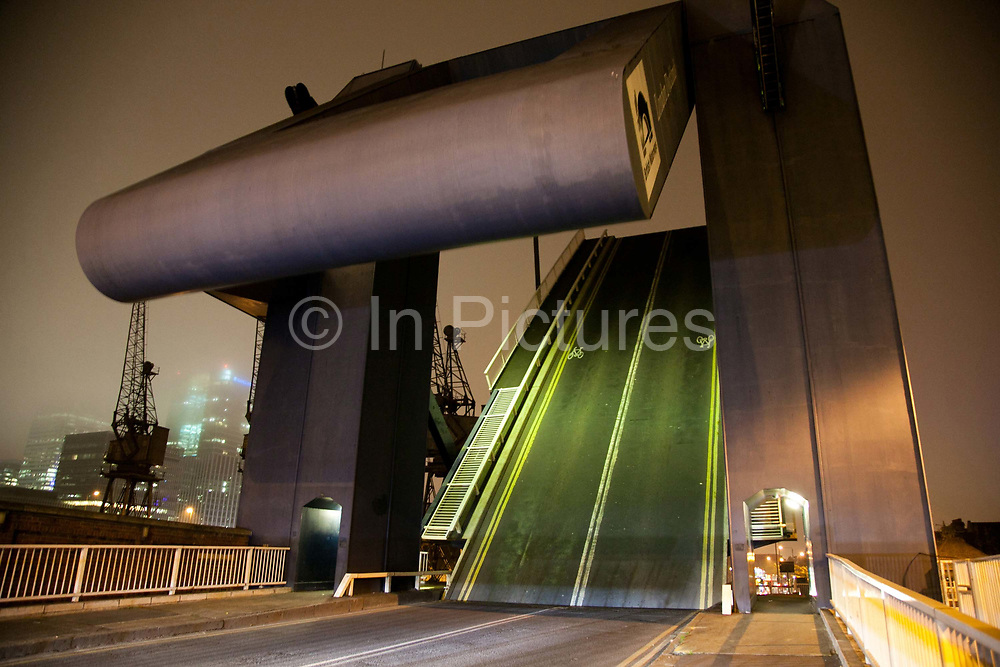 The East Entrance Lock is up to let the Greenpeace ship Rainbow Warrior lll out West India Docks and into the Thames