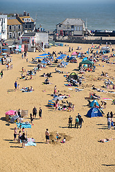© Licensed to London News Pictures. 20/04/2019. BROADSTAIRS, UK.  People enjoy the unusually warm weather at the seaside near Broadstairs in Kent.  The forecast is for the Easter bank holiday weekend to be even warmer.  Photo credit: Stephen Chung/LNP