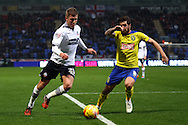 Jacob Butterfield of Huddersfield Town (r) looks to tackle Josh Vela of Bolton Wanderers. Skybet football league championship match, Bolton Wanderers v Huddersfield Town at the Macron stadium in Bolton, Lancs on Saturday 29th November 2014.<br /> pic by Chris Stading, Andrew Orchard sports photography.