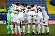 Peterborough United huddle during the EFL Sky Bet League 1 match between Oxford United and Peterborough United at the Kassam Stadium, Oxford, England on 16 February 2019.