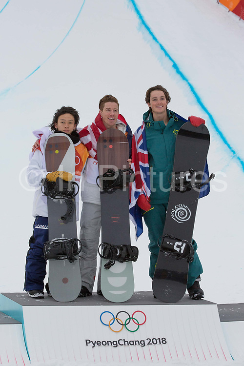 Shaun White, USA, GOLD with Ayumu Hirano, Japan, SILVER and Scotty James, Australis, BRONZE celebrates winning the mens Snowboard Halfpipe competition during the Pyeongchang Winter Olympics on 14th February 2018 in South Korea