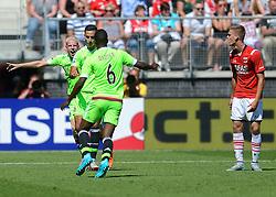 09-08-2015 NED: AZ - Ajax, Alkmaar<br /> Ajax verslaat AZ vrij eenvoudig met 3-0 / Anwar El Ghazi #21 scoort de 1-0 en viert dit ,et Davy Klaassen #10, Riechedly Bazoer #6. Rechts Markus Henriksen NOO #10