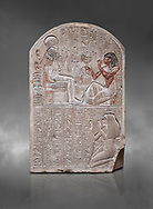 Ancient Egyptian stele dedicated to the god Khonsu by draftsman Pay, limestone, New Kingdom, 19th Dynasty, (1279-1213 BC), Deir el-Medina, Drovetti cat 1553. Egyptian Museum, Turin. Grey background .<br /> <br /> If you prefer to buy from our ALAMY PHOTO LIBRARY  Collection visit : https://www.alamy.com/portfolio/paul-williams-funkystock/ancient-egyptian-art-artefacts.html  . Type -   Turin   - into the LOWER SEARCH WITHIN GALLERY box. Refine search by adding background colour, subject etc<br /> <br /> Visit our ANCIENT WORLD PHOTO COLLECTIONS for more photos to download or buy as wall art prints https://funkystock.photoshelter.com/gallery-collection/Ancient-World-Art-Antiquities-Historic-Sites-Pictures-Images-of/C00006u26yqSkDOM
