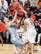 Jan. 8, 2011; Charlottesville, VA, USA;  North Carolina Tar Heels forward Tyler Zeller (44) is blocked by Virginia Cavaliers guard Joe Harris (12) during the game at the John Paul Jones Arena. North Carolina won 62-56. Mandatory Credit: Andrew Shurtleff-
