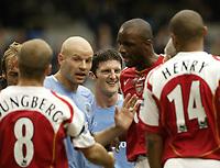 Photo. Aidan Ellis.<br />Manchester City v Arsenal.<br />Barclays Premiership.<br />25/09/2004.<br />Manchester's Jon Macken enjoys a smile as Danny Mills and Patrick Viera argue