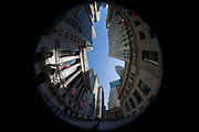 180 degree distorted fish-eye lens view of the New York Stock Exchange (NYSE) on Wall Street, Lower Manhattan. The extreme nature of this specialist lens bends straight lines and translates them into curves to show this famous street symbolises the US economy. Wall Street is a 0.7 miles (1.1 km), eight-block-long, street running west to east from Broadway to South Street on the East River in Lower Manhattan in the financial district of New York City. Over time, the term has become a metonym for the financial markets of the United States as a whole, the American financial sector or signifying New York-based financial interests. The NYSE is world's largest stock exchange by market capitalization of its listed companies at US$16.613 trillion as of May 2013. Average daily trading value was approximately US$169 billion in 2013.
