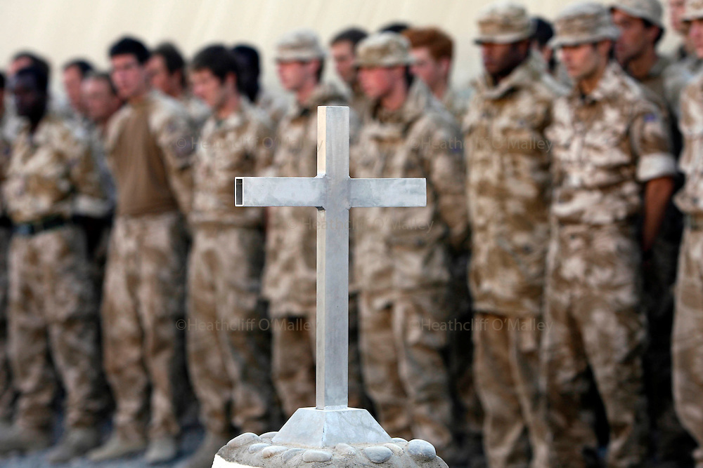 Mcc0018106 . SundayTelegraph..For the Sunday Telegraph..Soldiers at Fob Shawqat pay their respects to the men that were killed last week in an unprovoked attack by a rogue Afghan policeman in the Nad e'Ali district of Helmand province, southern Afghanistan...Afghanistan 9 November 09