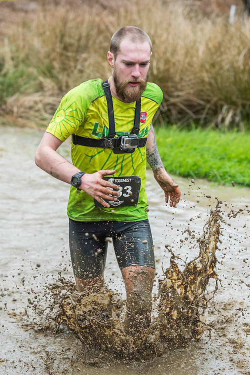People of all shapes and sizes took part, here with only 3 obstacles out of 36 - The Toughest race over obstacles and mud took place in Pippingford Park, Nutley, Uckfield, East Sussex. There were over 3000 competitors running as elite athletes or for fun over 8km.