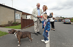 Labour leader Jeremy Corbyn speaks to locals whilst on a visit to Carol Woolford's home in Reading West, to speak to her about fuel poverty.
