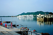 India, Rajasthan, Udaipur view of the Taj Lake Palace hotel, which covers an entire island in the Pichola Lake
