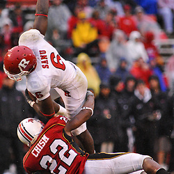Sep 26, 2009; College Park, MD, USA; Maryland defensive back Cameron Chism (22) tackles Rutgers wide receiver Mohamed Sanu (6) after a catch during Rutgers' 34-13 victory over Maryland in NCAA college football at Byrd Stadium.