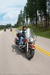 Jonathan Pite on the Aidan's Ride to raise money for the Aiden Jack Seeger nonprofit foundation to help raise awareness and find a cure for ALD (Adrenoleukodystrophy) during the annual Sturgis Black Hills Motorcycle Rally. Riding between Nemo and Rapid City, SD, USA. Tuesday August 8, 2017. Photography ©2017 Michael Lichter.