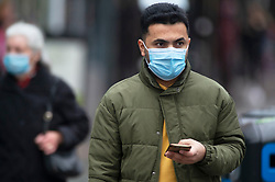 © Licensed to London News Pictures. 14/12/2020. <br /> Sidcup, UK. Shoppers in Sidcup High Street, Sidcup in the London borough of Bexley wearing protective face masks as the news breaks that London will go into tier three from Wednesday. Photo credit:Grant Falvey/LNP