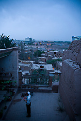 A resident prays in old city in Kashgar, China.