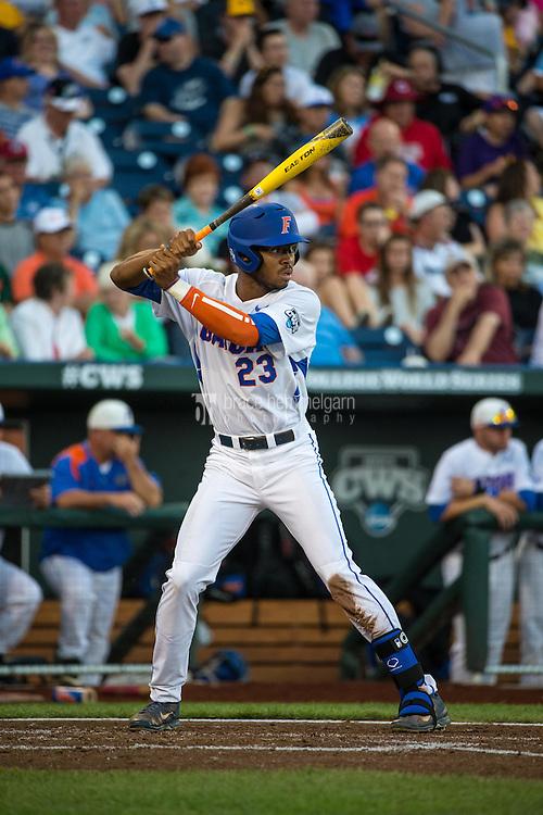 Buddy Reed (23) of the Florida Gators bats during a game between the Miami Hurricanes and Florida Gators at TD Ameritrade Park on June 13, 2015 in Omaha, Nebraska. (Brace Hemmelgarn)