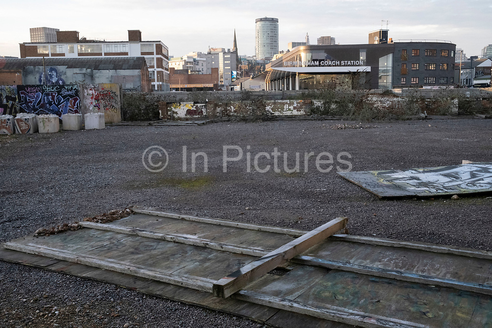 View looking across overgrown and disused waste ground, awaiting redevelopment, which seems to have stalled in the last year in the industrial area of Deritend, which lies less than half a mile from the city centre on 7th January 2021 in Birmingham, United Kingdom. Birmingham is undergoing a massive transformation called the Big City Plan which involves the controversial regeneration of the city centre as well as a secondary zone reaching out further. The Big City Plan is the most ambitious, far-reaching development project being undertaken in the UK. The aim for Birmingham City Council is to create a world-class city centre by planning for the next 20 years of transformation.