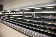 Empty supermarket shelves of what should be full of meat as people continue to stockpile food due to the Covid-19 outbreak on 22nd March 2020 in London, England, United Kingdom. Coronavirus or Covid-19 is a new respiratory illness that has not previously been seen in humans. While much or Europe has been placed into lockdown, the UK government has announced more stringent rules as part of their long term strategy, and in particular social distancing.