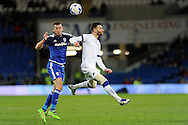 Cardiff City's Joe Ralls (l) and Leeds United's Mirco Antenucci challenge for a header. Skybet football league championship match, Cardiff city v Leeds Utd at the Cardiff city stadium in Cardiff, South Wales on Tuesday 8th March 2016.<br /> pic by Carl Robertson, Andrew Orchard sports photography.