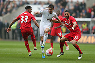 Jack Cork of Swansea city © goes past Kevin Stewart of Liverpool (R) . Barclays Premier league match, Swansea city v Liverpool  at the Liberty Stadium in Swansea, South Wales on Sunday 1st May 2016.<br /> pic by  Andrew Orchard, Andrew Orchard sports photography.