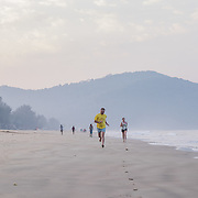 Early morning jogging on Agonda beach in south Goa.