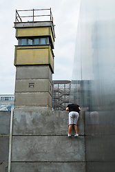 Boy looks into former death strip of Berlin Wall on Bernauer Strasse and Ackerstrasse in Berlin Germany