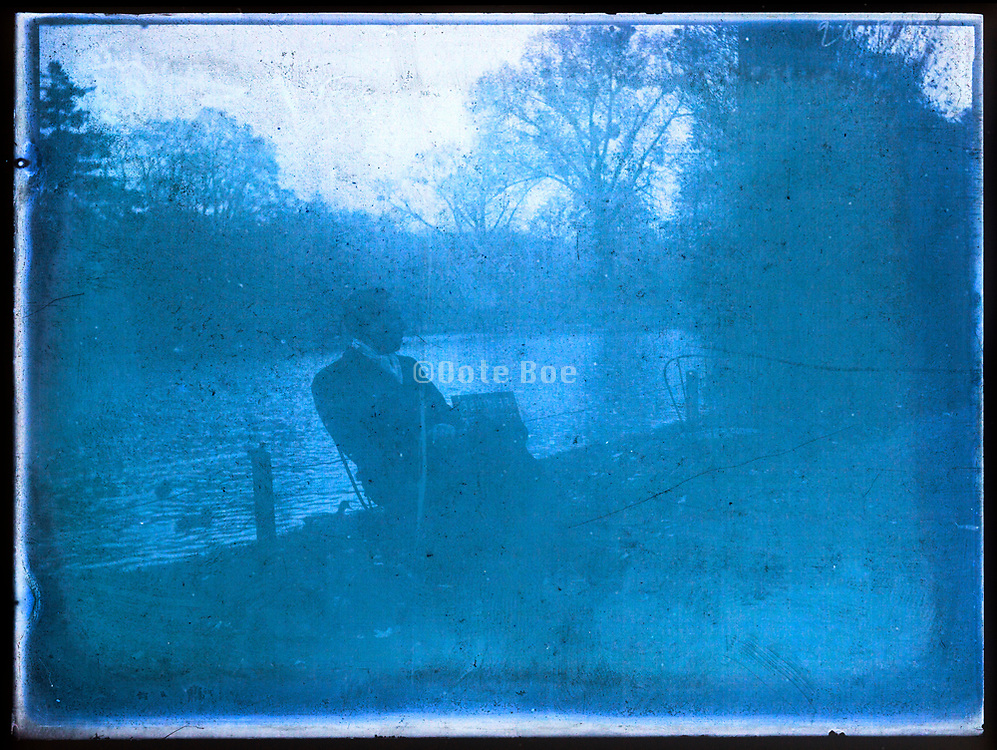 deteriorating glass plate of man sitting by a park lake France 1920s 1930s
