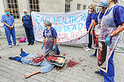 """NHS workers perform a first aid situation subjecting Prime Minister Brosi Johnson during a protest demanding pay rise outside BBC Broadcasting House in central London on Saturday, Sept 12, 2020.  NHS workers also accused BBC of holding back the information over the NHS pay rise. Grassroot NHS workers are angry after they were left out of plans to give almost a million to public sector workers an above-inflation increase. Ministers say they were working with unions to ensure the """"best possible"""" pay package for all health workers. (VXP Photo/ Vudi Xhymshiti)"""