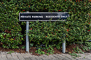 A Private Parking - Residents Only sign seen on a residential street in east London, England on December 20, 2018