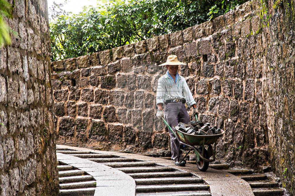 A worker restoring the Fortaleza do Monte or Monte Forte Macau.