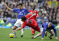Photo: Paul Thomas.<br /> Everton v Middlesbrough. The Barclays Premiership.<br /> 06/11/2005.<br /> <br /> Everton players  Tim Cahill and Tony Hibbert tackle Fabio Rochemback.