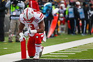 Ameer Abdullah takes a knee during the final regular season game of his career - a 37-34 overtime win against Iowa at Kinnick Stadium on Nov. 11, 2014. © Aaron Babcock