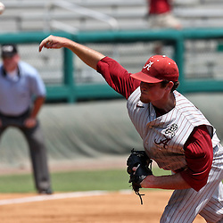 June 03, 2011; Tallahassee, FL, USA;  Alabama Crimson Tide fan Nathan Kilcrease (28) pitches during the second inning against the UCF Knights in the 2011 Tallahassee Regional at Dick Howser Stadium. Alabama defeated UCF 5-3.  Mandatory Credit: Derick E. Hingle