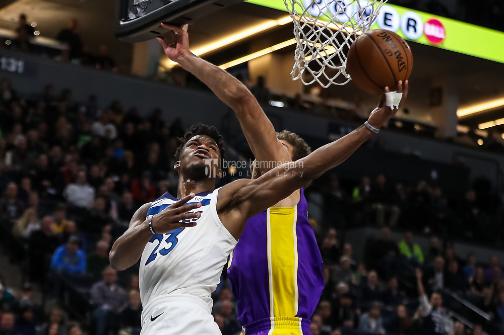 Feb 15, 2018; Minneapolis, MN, USA; Minnesota Timberwolves guard Jimmy Butler (23) shoots over Los Angeles Lakers center Brook Lopez (11) during the fourth quarter at Target Center. Mandatory Credit: Brace Hemmelgarn-USA TODAY Sports