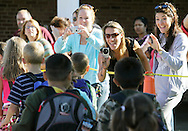 Students walk past the parent photo op area at Scotchtown Avenue Elementary School in Goshen on the first day of school, Wednesday, Sept. 2, 2009.